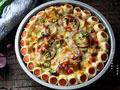火腿花边培根披萨